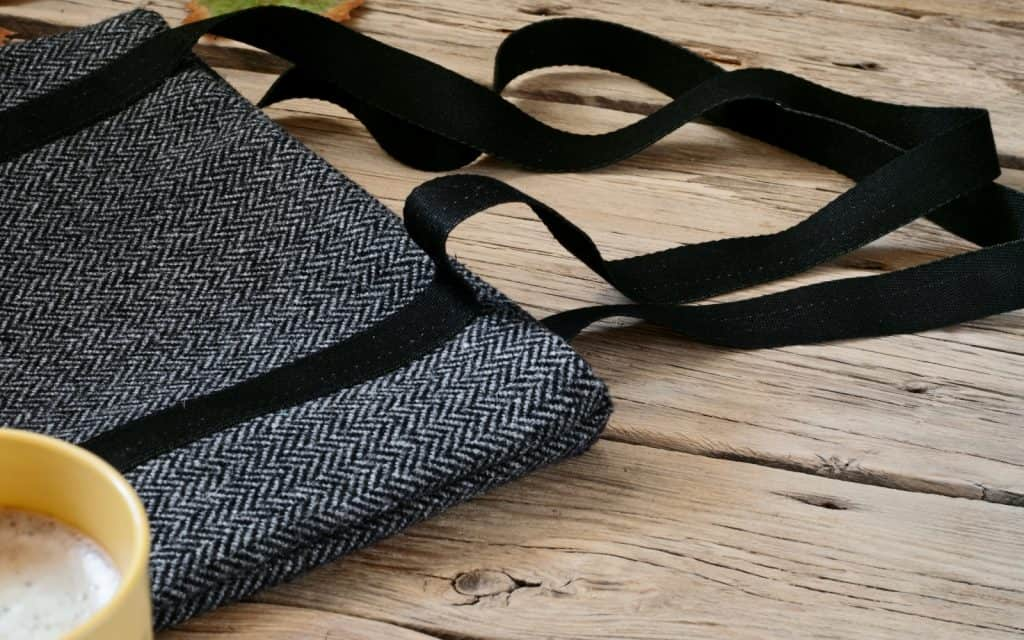 a gray homemade woolen sugar glider pouch