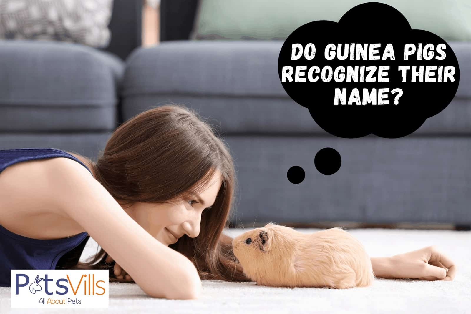 a lady smiling and staring with her brown guinea thinking