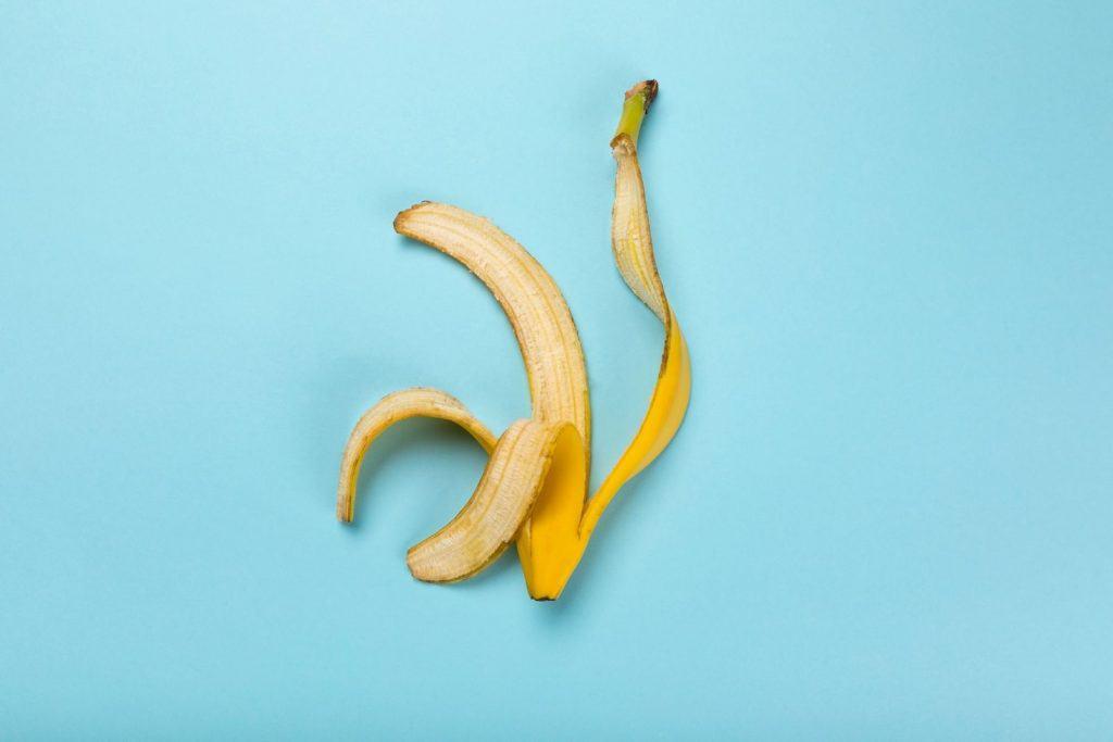 banana peeling in a light blue background. can guinea pigs eat banana peels?