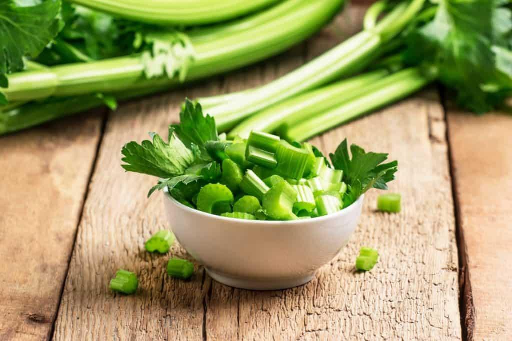 a white bowl full of chopped celeries