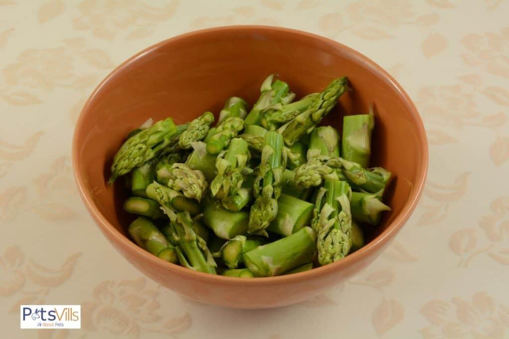 chopped asparagus in a ceramic bowl