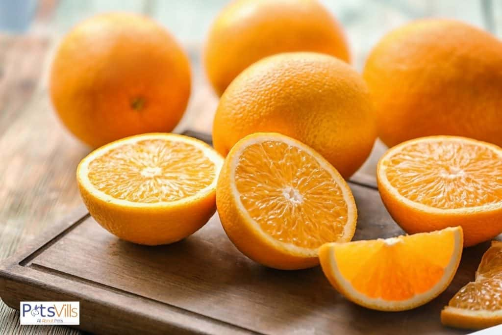 fresh oranges on a wooden board