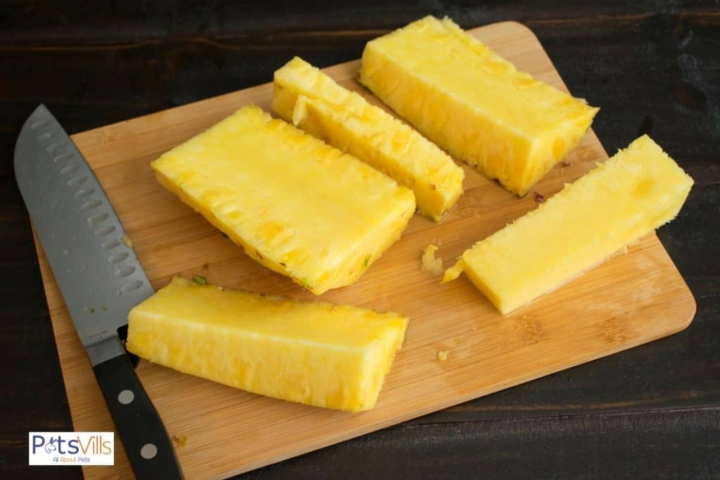 peeled and cut pineapples on a chopping board